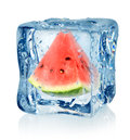 Ice cube and watermelon Royalty Free Stock Photo