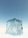 Ice cube on white surface Royalty Free Stock Photos
