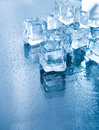 Ice cubes in blue ambient light. Royalty Free Stock Photos