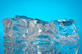 Ice cubes on a blue background Royalty Free Stock Photos