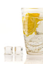 Ice cubes and lemon drink in glass Stock Photography
