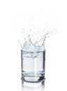 Ice cubes splashing into glass of water, Royalty Free Stock Photo