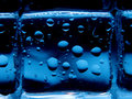 Ice cubes with water drops background Stock Photography