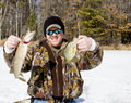 Ice fishing catch Royalty Free Stock Image
