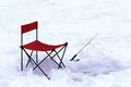 Ice fishing chair and pole Vermont Royalty Free Stock Photo