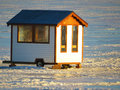 Ice fishing shack small on the frozen lake taken at the end of the day Royalty Free Stock Photos