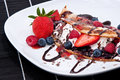 Ice in fresh pan cake with fruits mixed on black background Stock Photos