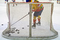 Ice hockey net hokey filled with pucks seen from behind Stock Images