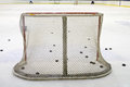 Ice hockey net hokey filled with pucks seen from behind Stock Photos