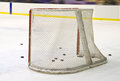 Ice hockey net hokey filled with pucks seen from behind Stock Photography