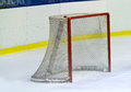 Ice hockey net with some pucks Royalty Free Stock Image
