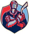 Ice hockey player front with stick retro illustration of an holding arms crossed facing done in style Stock Images