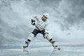 Ice hockey player on the outdoor Royalty Free Stock Image