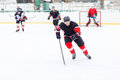Ice hockey player with stick skating on the rink. Royalty Free Stock Photo
