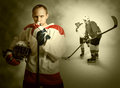 Ice hockey players on dramatick background Royalty Free Stock Image