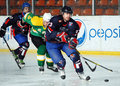 Ice hockey players pictured in action during the friendly game between steaua bucharest and south africa which took place on mihai Royalty Free Stock Photography