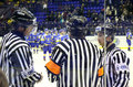 Ice-hockey referees in action Stock Image