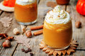 Ice honey pumpkin spice latte with whipped cream the toning selective focus Royalty Free Stock Images