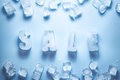 Ice letters SALE and ice cubes
