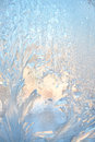 Ice natural background frosty pattern at a winter window glass Stock Photos