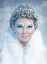 Ice queen beautiful woman in winter professional makeup with white fur Stock Photography