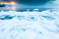 Ice sea scape and snow dramatically scupted at sunrise Stock Photos