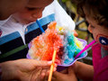 Ice shavings kids enjoying refreshing on summer day Royalty Free Stock Image