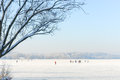 Ice skaters on a frozen lake ii enjoy alpine cold wintry day Royalty Free Stock Images
