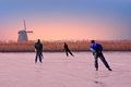 Ice skating in the countryside from Netherlands at sunset Royalty Free Stock Photo