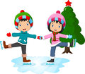 Ice skating little girl and boy Royalty Free Stock Photo