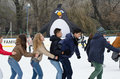 Ice skating teen skaters on a rink in bucharest romania december Stock Image