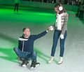 Ice skating young beautiful couple smiling on the indoors rink Royalty Free Stock Photos