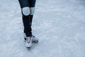 Ice skating young girl with hard knee protection Stock Images