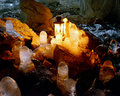 Ice stalactites in the cave a with a decorative candle on an old lamp Royalty Free Stock Image