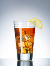 Ice tea close up view of a glass with iced and lemon on blue back Royalty Free Stock Photo