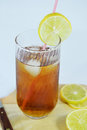 Ice tea a glass of cold garnish with a slice of lemon on a chopping board Stock Photography
