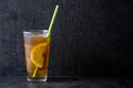 Ice tea with lemon. Black stone background Royalty Free Stock Photo