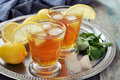Ice tea with lemon in glass and mint on metal tray Royalty Free Stock Photos