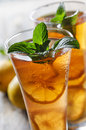 Ice tea refreshing with lemon and mint Stock Photos