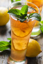 Ice tea refreshing with lemon and mint Royalty Free Stock Photos