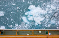 Iceberg beside cruise ship Royalty Free Stock Photo