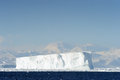 Iceberg in front of coast antarctica Stock Image