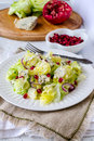 Iceberg lettuce with blue cheese and pomegranate seeds Royalty Free Stock Image