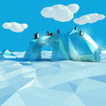 Iceberg with penguins in the arctic ocean