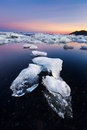 Icebergs beached on jokulsarlon lagoon in iceland during sunrise Royalty Free Stock Photos