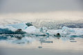 Icebergs floating in fron of a glacier jokulsarlon iceland on sunset Royalty Free Stock Image