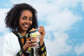 Icecream african girl happy ethiopian wearing a traditional costume eating Stock Images