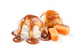 Icecream and caramel two balls under the topping Royalty Free Stock Photos