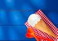 Icecream cone on checkered napkin Stock Photo