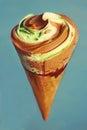 Icecream cone with chocolate and pistachio icecream Royalty Free Stock Photo